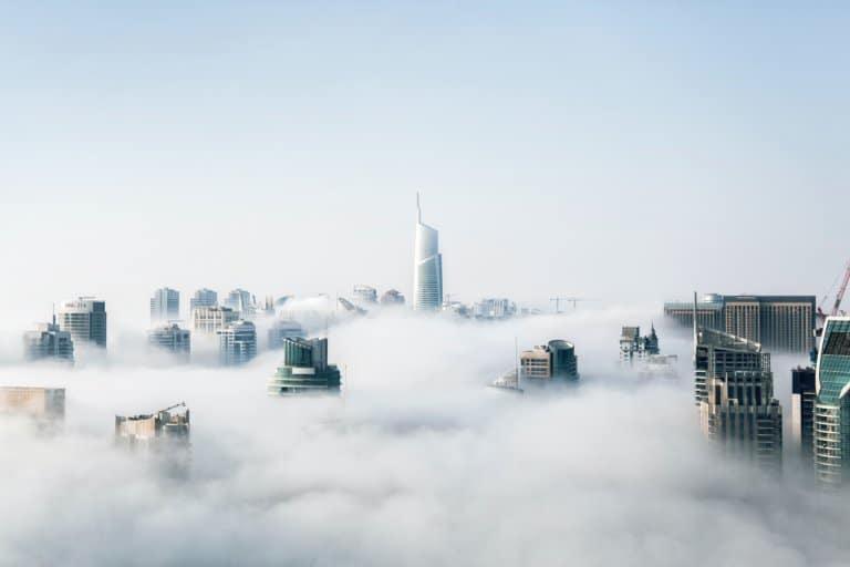 The top of skyscrapers above the clouds