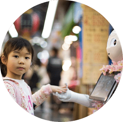 Young girl shaking hands with a robot